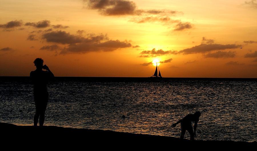Sailboat Photograph - Sailboat Hits Sunset At Aruba Beach by Ron Bartels