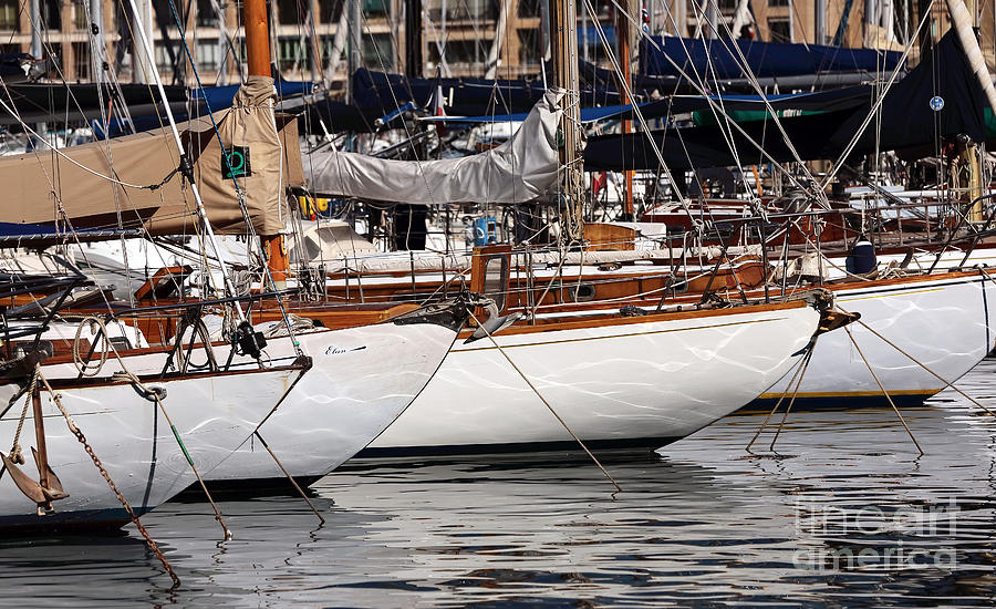 Sailboat Hulls In The Port Photograph - Sailboat Hulls In The Port by John Rizzuto