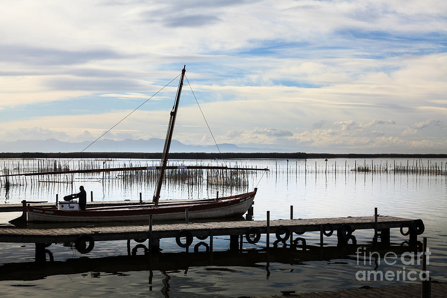 Sailing boat being prepared on the jetty on Lake Albufera Spain by Peter Noyce