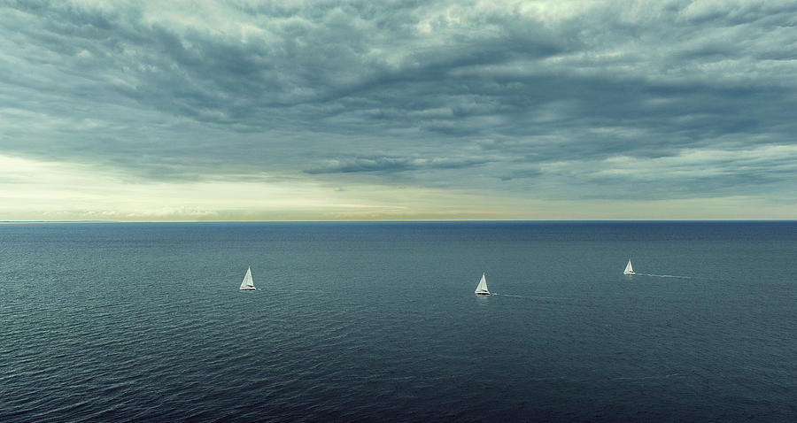 Sailing Boats At The Ocean Photograph by Daniel Grizelj