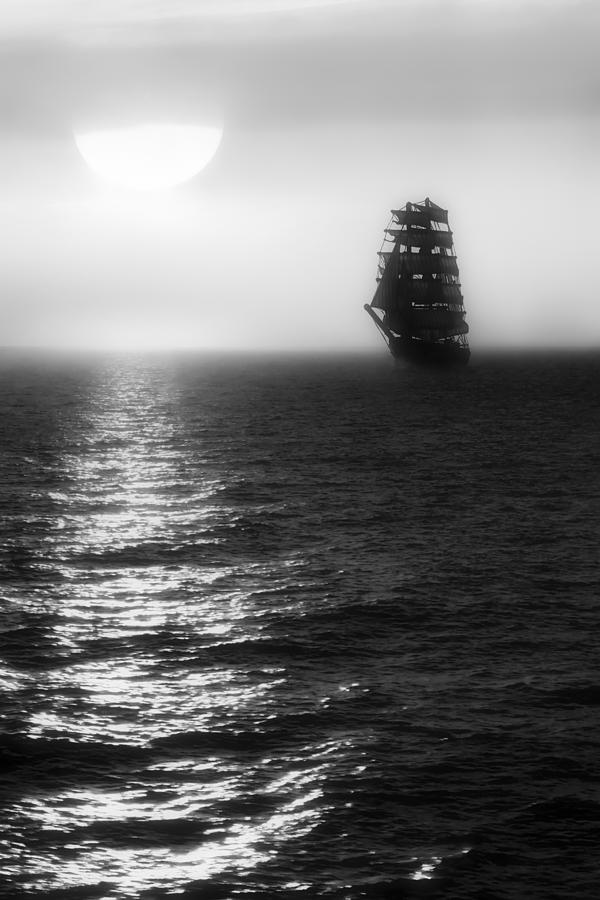 Sailing Ship Photograph - Sailing Out Of The Fog - Black And White by Jason Politte
