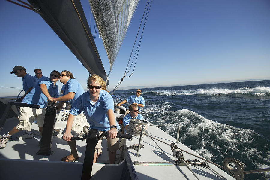 Sailing team on yacht Photograph by Moodboard