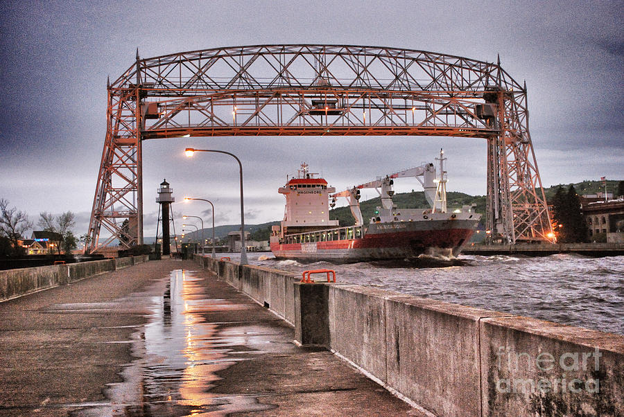 Aerial Lift Bridge Photograph - Sailing Through The Duluth Aerial Lift Bridge by Ever-Curious Photography