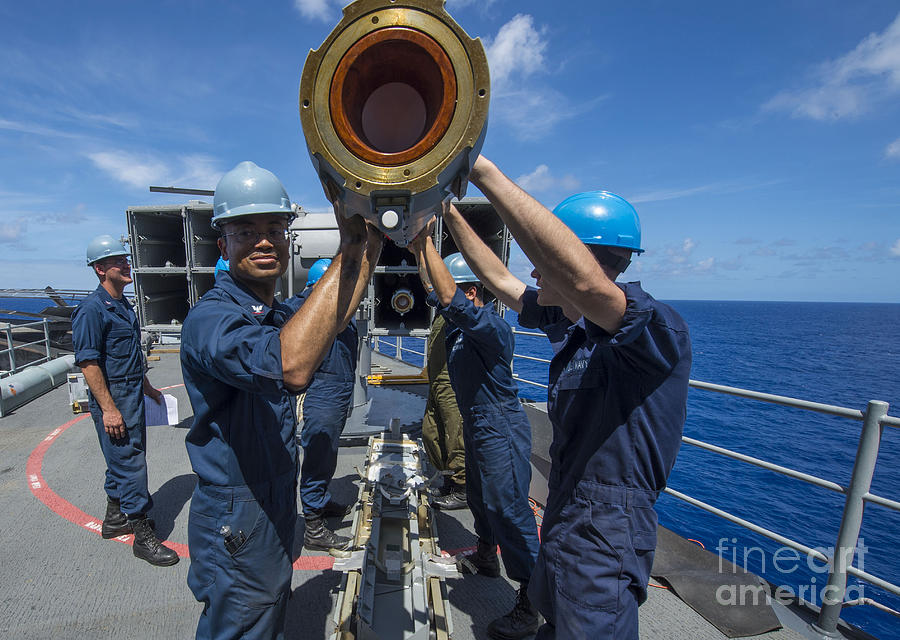 Uss Boxer Photograph - Sailors Load Rim-7 Sea Sparrow Missiles by Stocktrek Images