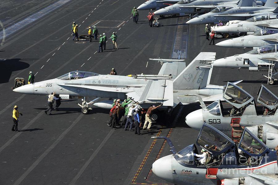 Sailors Push An Fa-18c Hornet Photograph