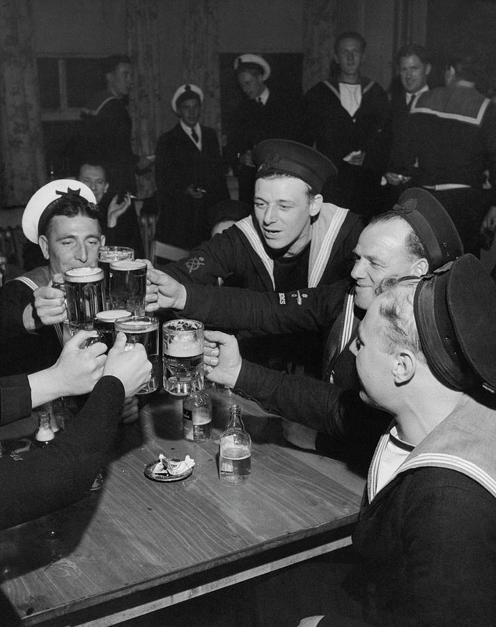 Sailors Toasting In Celebration Of Victory Photograph by Jacob Lofman