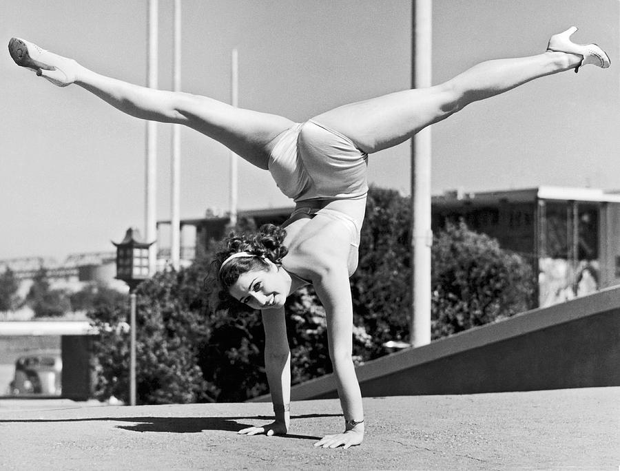 1939 Photograph - Sally Rand Combines A Hand Stand With The Splits by Underwood Archives