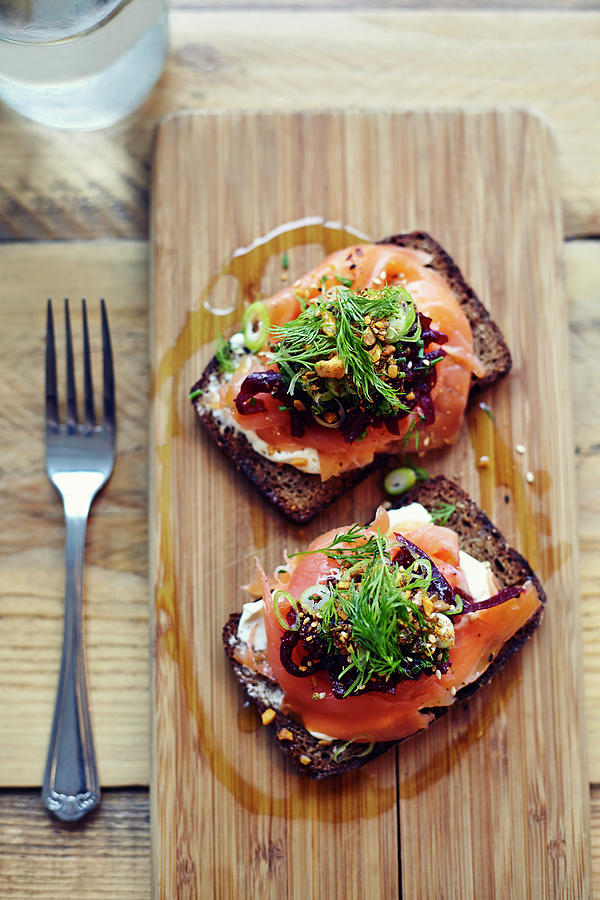 Salmon Tartine On Rye Bread On Wooden Photograph by Jake Curtis
