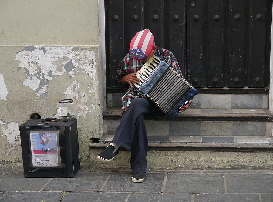 San Juan Accordion Player by Richard Reeve