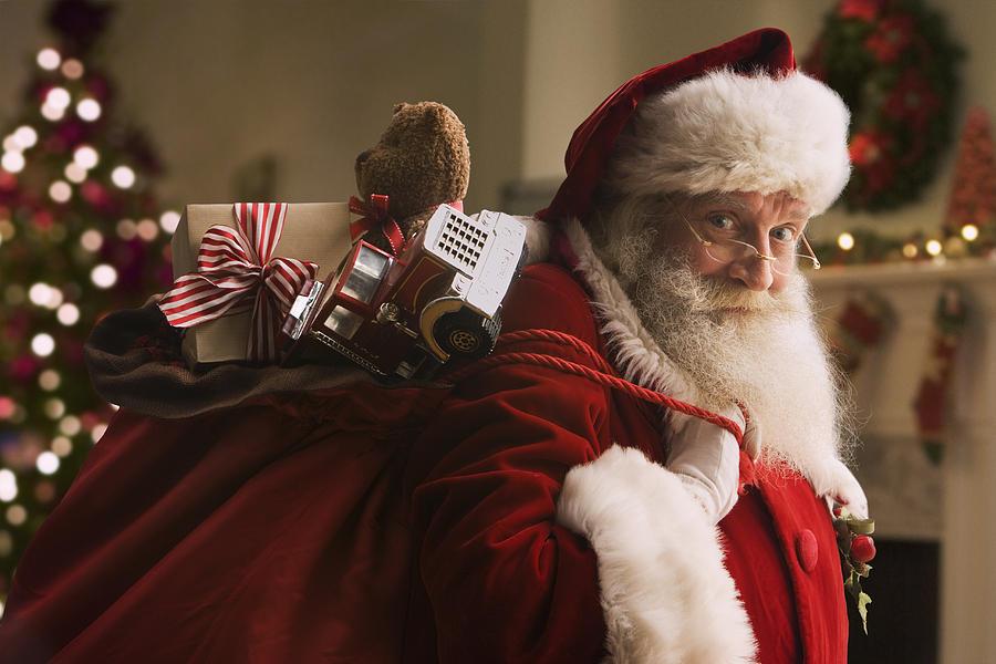 Santa Claus Carrying Sack Of Gifts, Portrait, Close-up Photograph by Jose Luis Pelaez