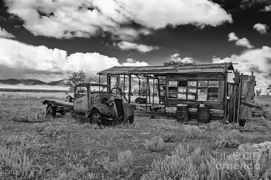 Black And White Photograph - Schellbourne Station And Old Truck by Robert Bales