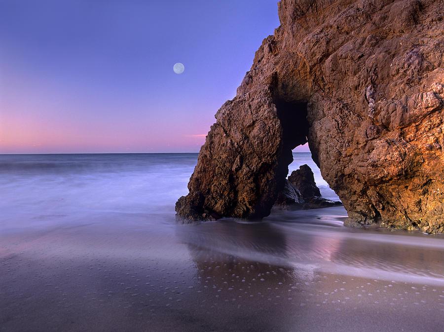 Sea Arch And Full Moon Over El Matador Photograph by Tim Fitzharris