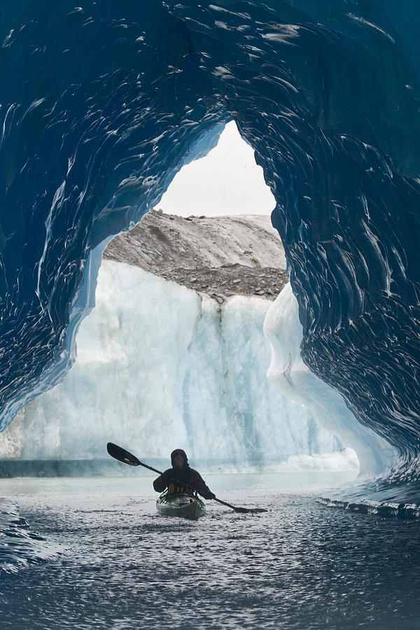 Day Photograph - Sea Kayaker Paddles Through An Ice Cave by Doug Demarest