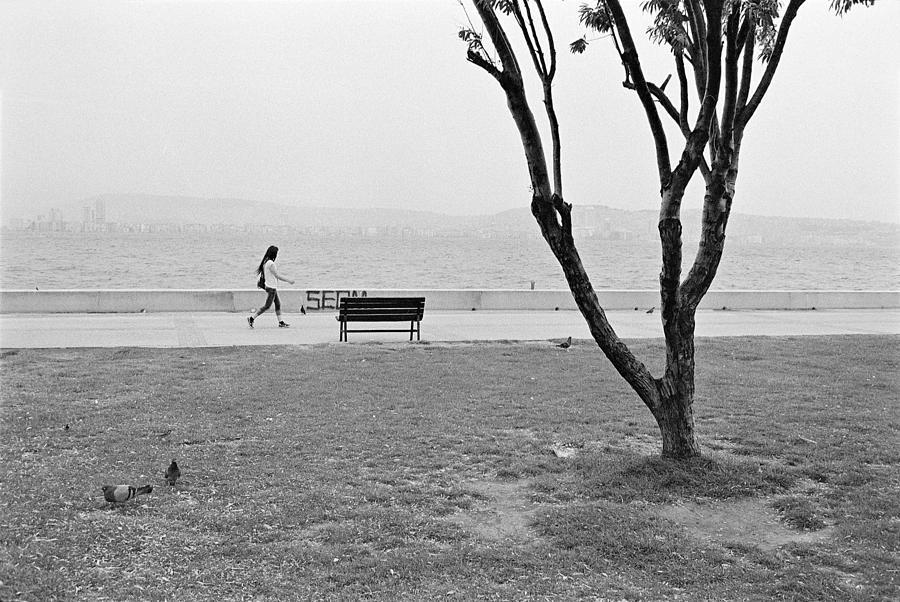 Street Photography Photograph - Sea-side Walk by Ilker Goksen