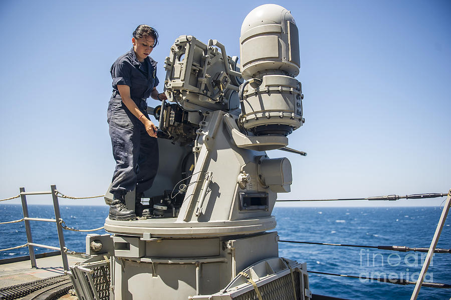 Us Navy Photograph - Seaman Performs Maintenance On A Mark by Stocktrek Images