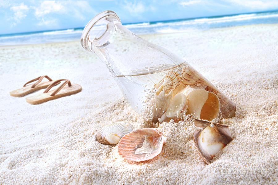 Beach Photograph - Seashells In A Bottle On The Beach by Sandra Cunningham