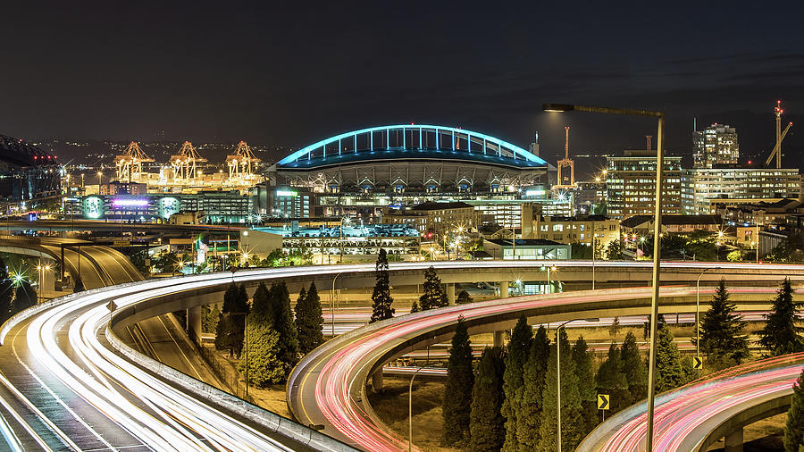 Seattle And Curved Road Light Trails Photograph by Michael Lee