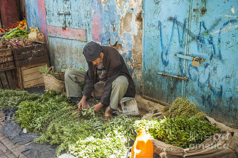 Market Photograph - Selling Herbs In The Souk by Patricia Hofmeester