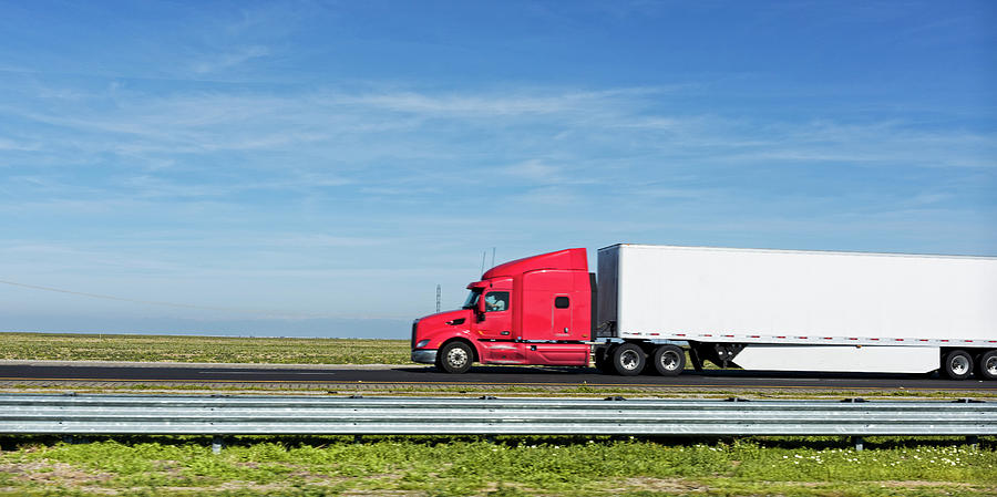 Color Image Photograph - Semi Truck Moving On The Highway by Panoramic Images