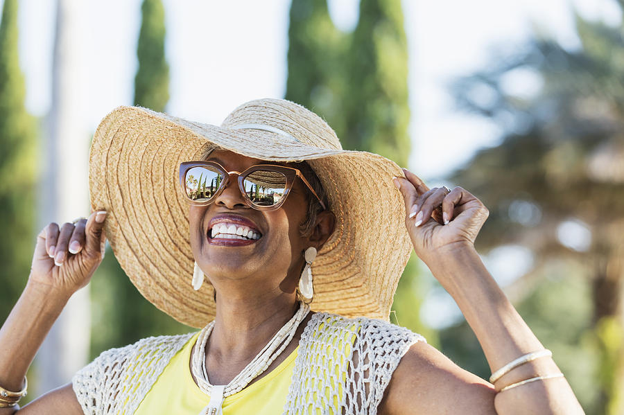 Senior African-American woman wearing sunglasses Photograph by Kali9