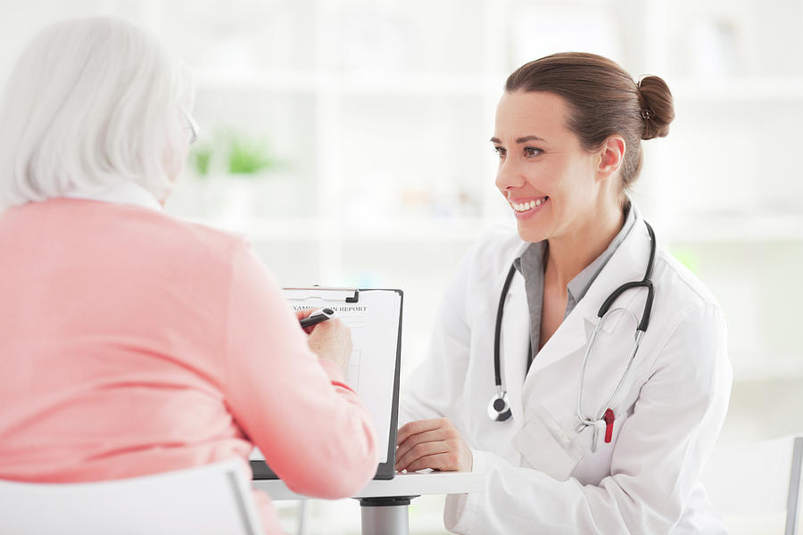 Senior Woman With Doctor Photograph by Svetikd