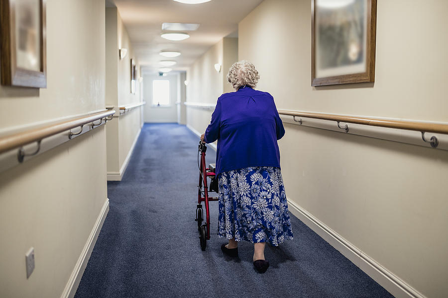 Senior Woman with Walker in a Care Home Photograph by SolStock