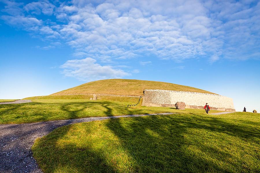 Newgrange Photograph - Shadows Fall On Newgrange In Ireland by Mark E Tisdale