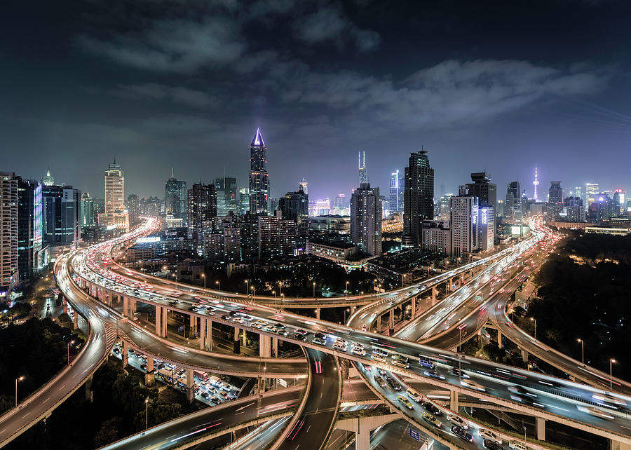 Shanghai, Busy Road Intersection At Dusk Photograph by Martin Puddy