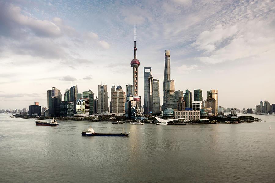 Shanghai Skyline And Huangpu River Photograph by Martin Puddy