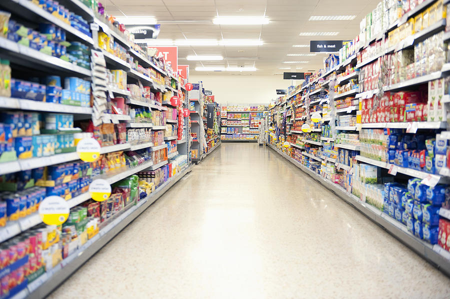 Shelves in grocery store aisle Photograph by Jacobs Stock Photography Ltd