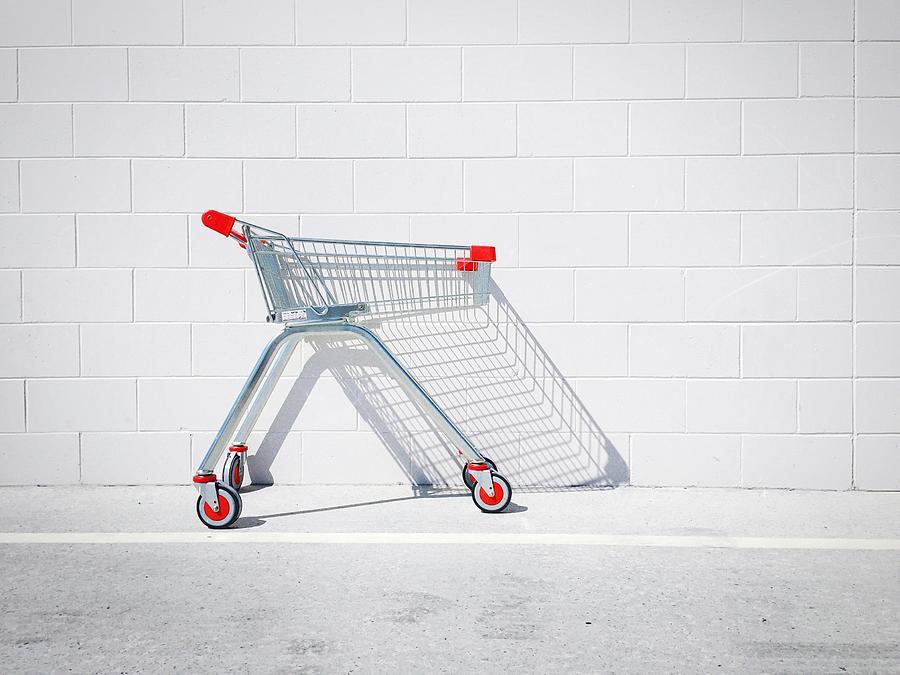 Shopping Cart Against White Wall Photograph by Glenn Homann / Eyeem