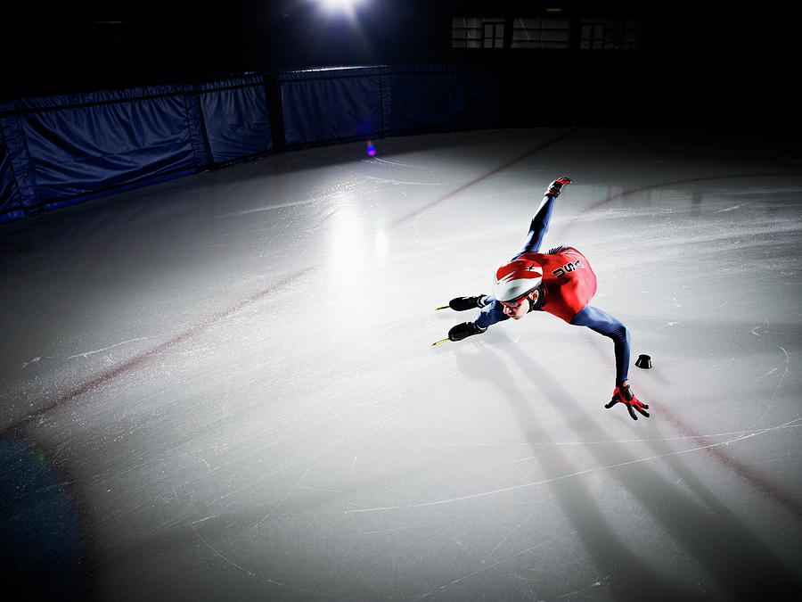 Short Track Speed Skater Making Turn Photograph by Thomas Barwick