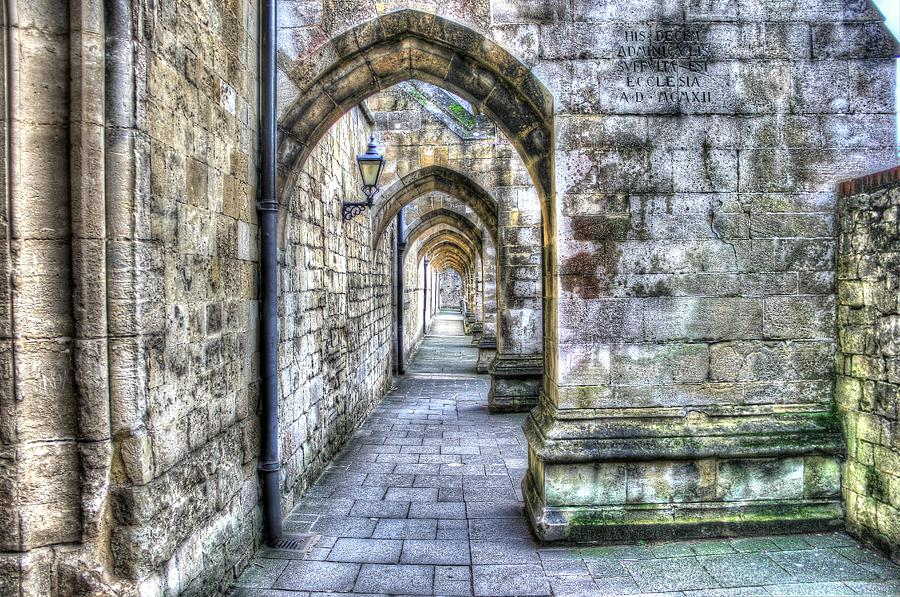 Passage Photograph - Side passage at Winchester cathedral by Peggy Berger