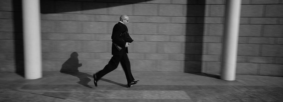 Color Image Photograph - Side Profile Of A Businessman Running by Panoramic Images