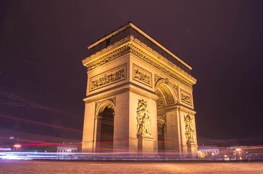 side vie of arc de triomphe in paris at night photograph by henri