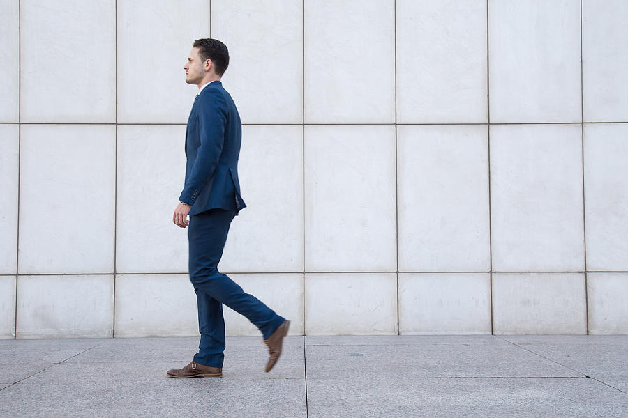 Side View Of Businessman Walking On Footpath Photograph by Pablo Benitez Lope / EyeEm