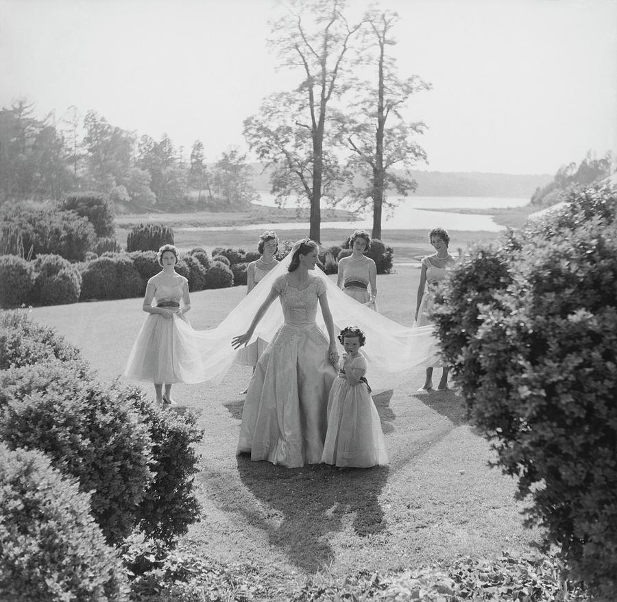 Sidney Bacon In Garden With Her Bridesmaids Photograph by Horst P. Horst