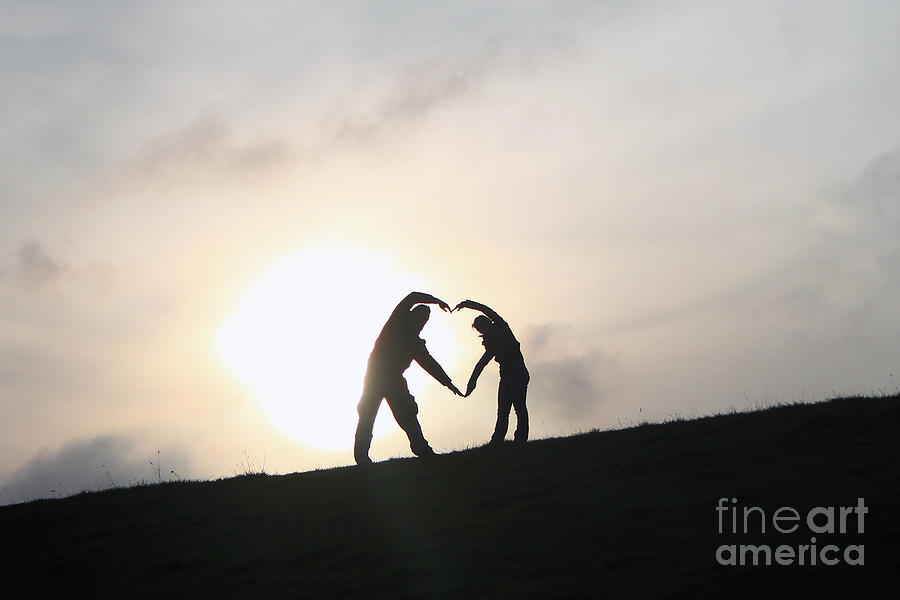 Silhouette Photograph - Silhouette Couple Forming A Heart by Lars Ruecker