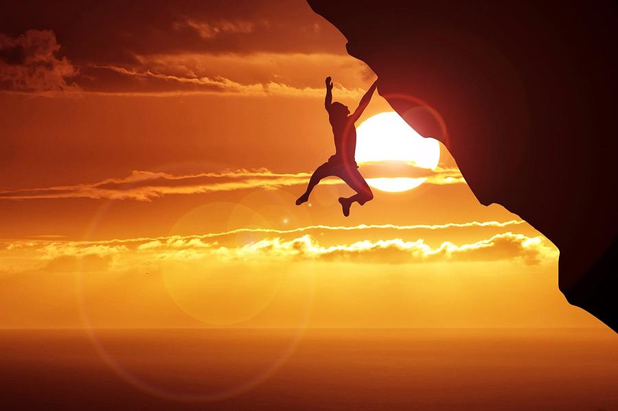 Silhouette Man Hanging On Cliff Against Photograph by Stijn Dijkstra / Eyeem