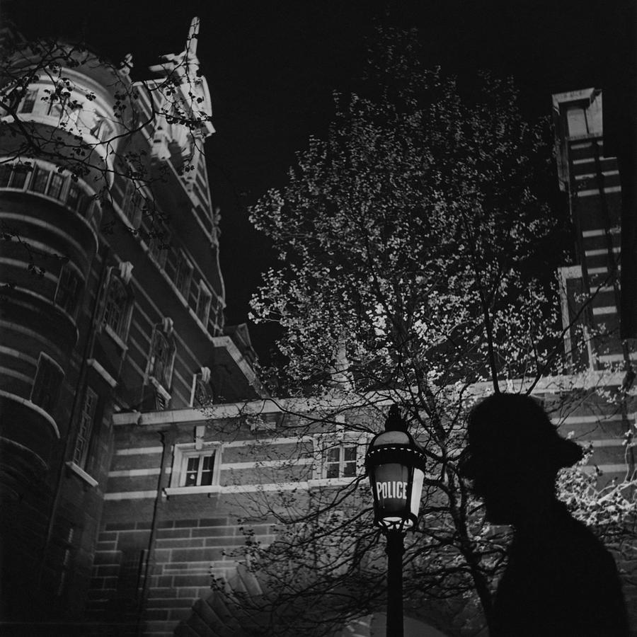 Silhouette Of A British Policeman At Night Photograph by Roger Schall