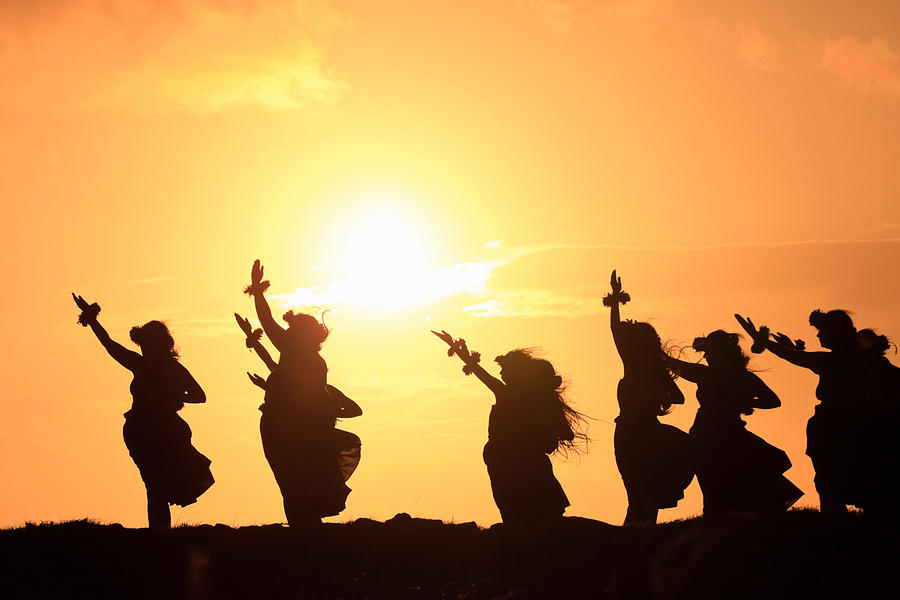 Color Image Photograph - Silhouette Of Hula Dancers At Sunrise by Panoramic Images