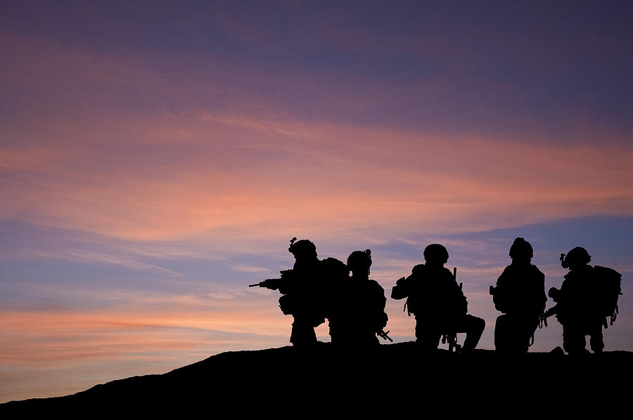 Army Photograph - Silhouette Of Modern Troops In Middle East Silhouette Against Be by Matthew Gibson