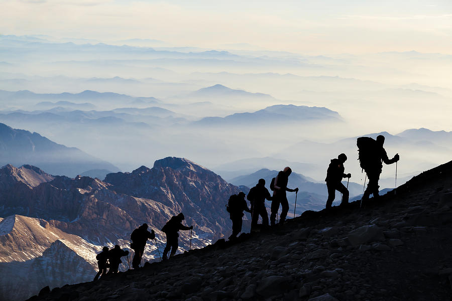 Silhouettes of hikers At Dusk Photograph by Guvendemir