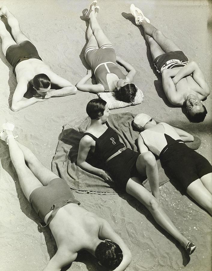 Simone Demaria And Models Sunbathing On A Beach Photograph by George Hoyningen-Huene