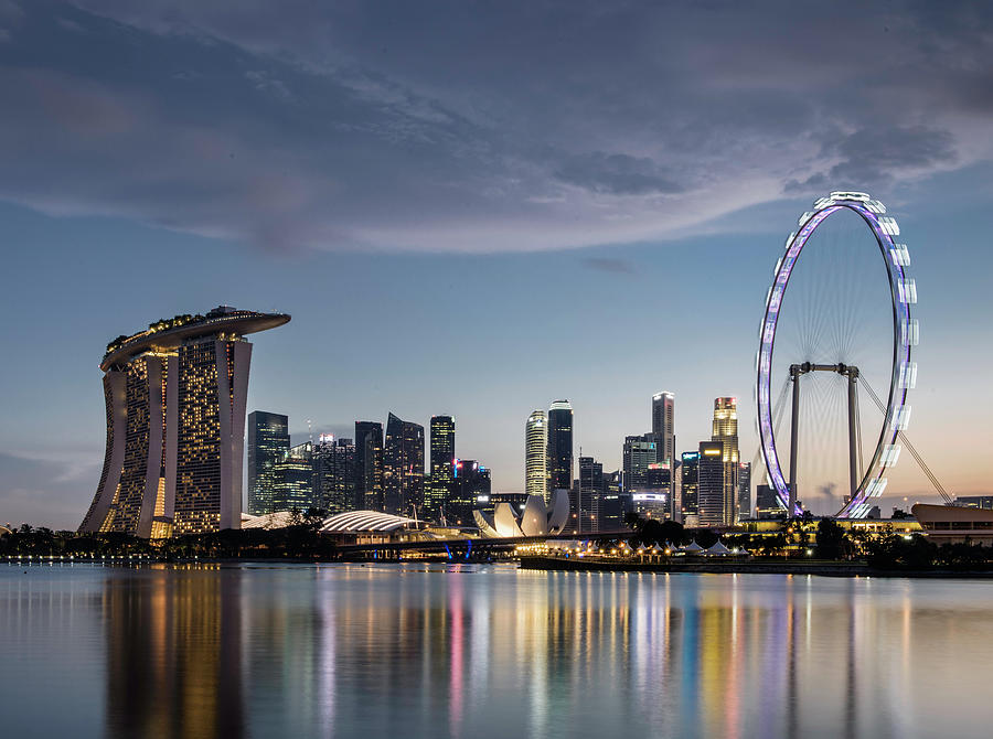 Singapore Skyline At Dusk Photograph by Martin Puddy