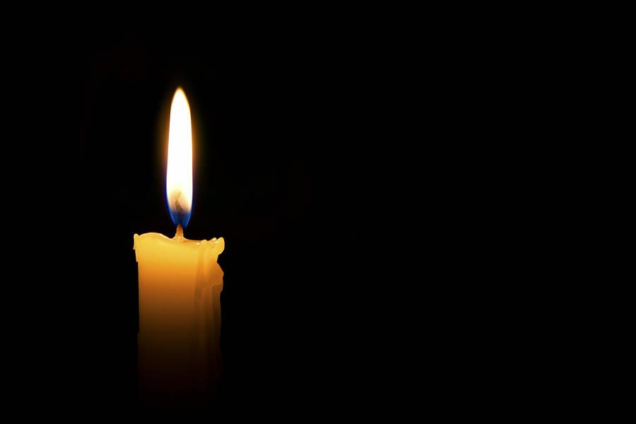 Single lit candle with quite flame Photograph by Apomares