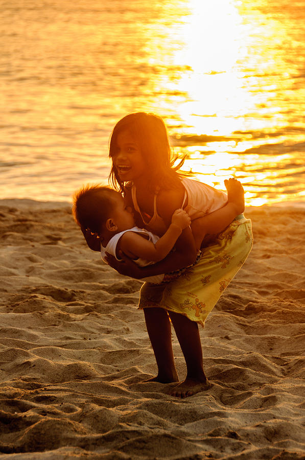 Asia Photograph - Sister And Brother On The Beach by Colin Utz