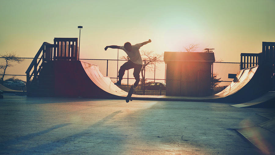 Skateboarder Jumping Photograph by Fran Polito