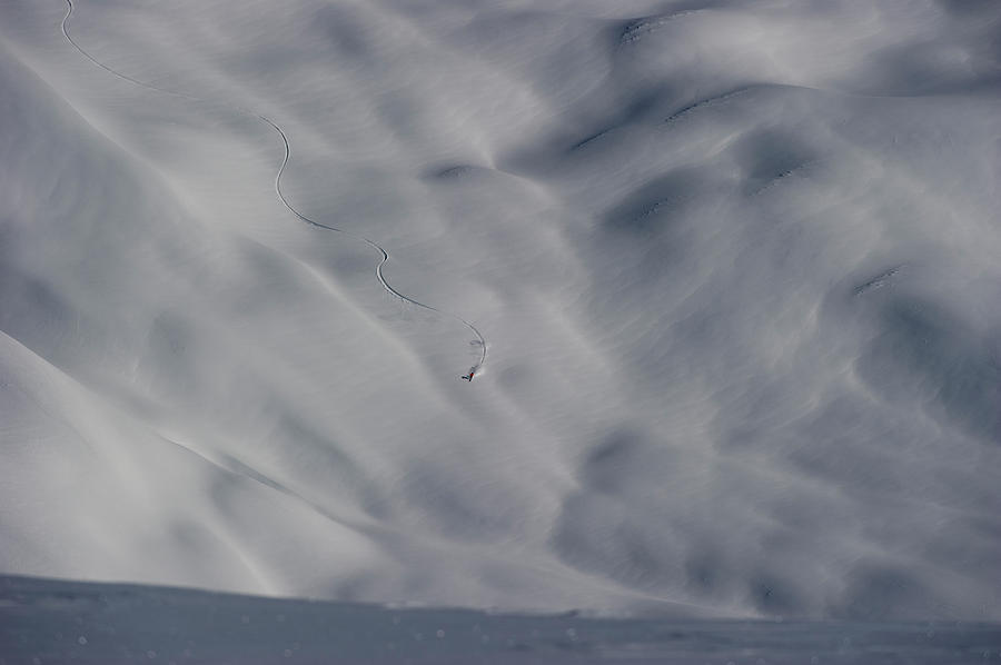 Adventure Photograph - Skier Carving A Snow Landscape by Topher Donahue