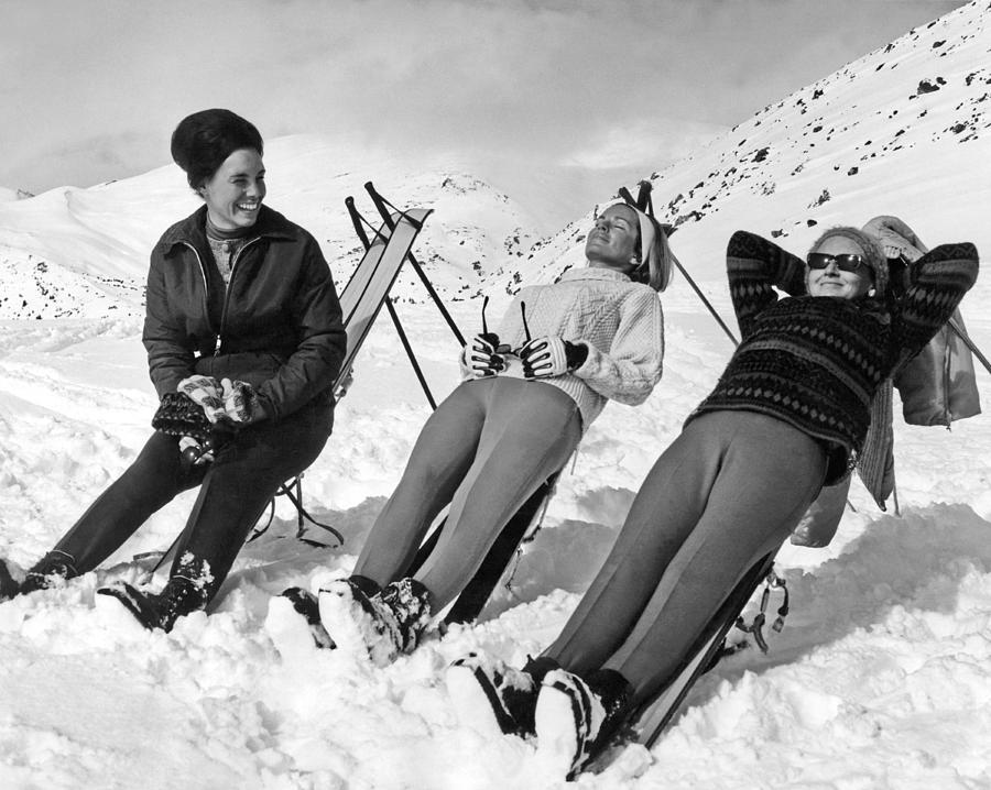 1956 Photograph - Skiers Basking In The Sun by Underwood Archives